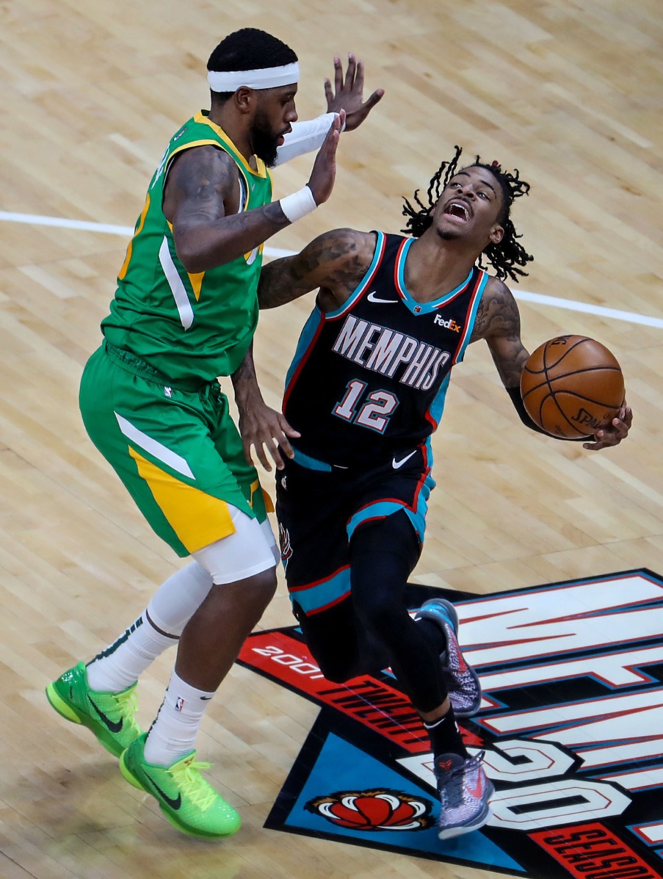 <strong>Grizzlies point guard Ja Morant (12) gets fouled by the Utah Jazz on March 31.</strong> (Patrick Lantrip/Daily Memphian)