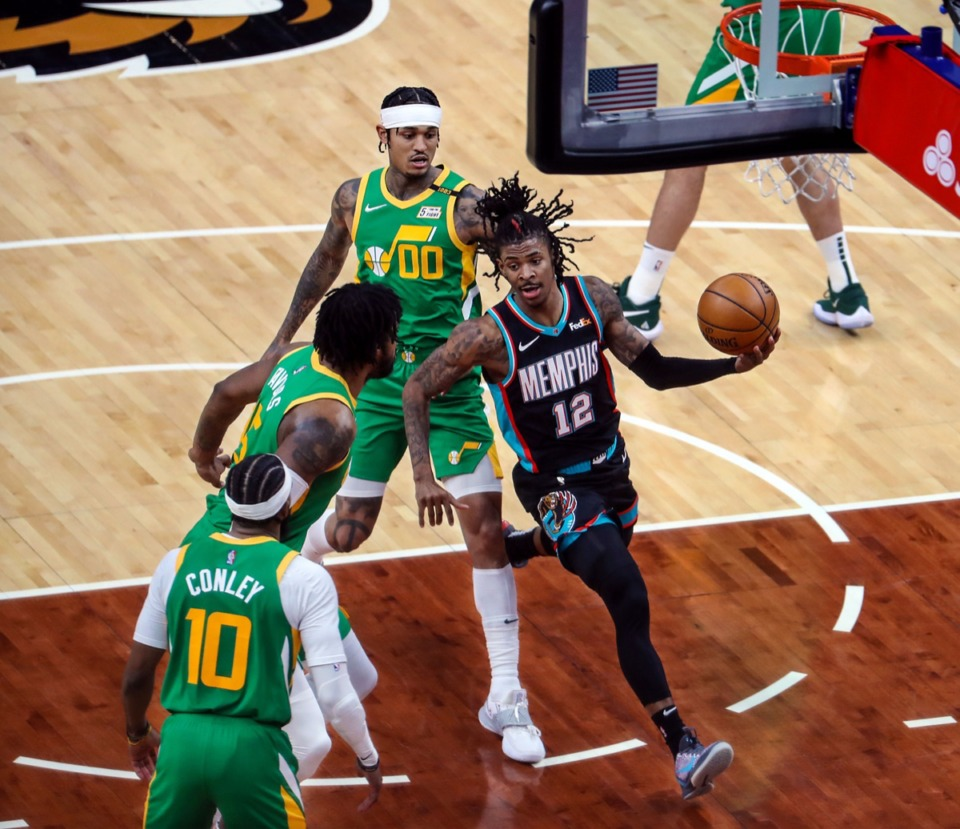 <strong>Grizzlies point guard Ja Morant (12) attacks the basket on March 31.</strong> (Patrick Lantrip/Daily Memphian)