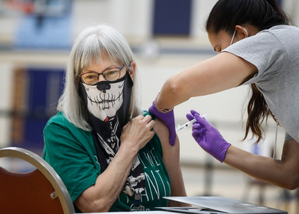 <strong>Art teacher Leanne Wilson receivers a vaccine shot during Arlington High School&rsquo;s vaccination event on Friday, March 26, 2021.</strong> (Mark Weber/The Daily Memphian)