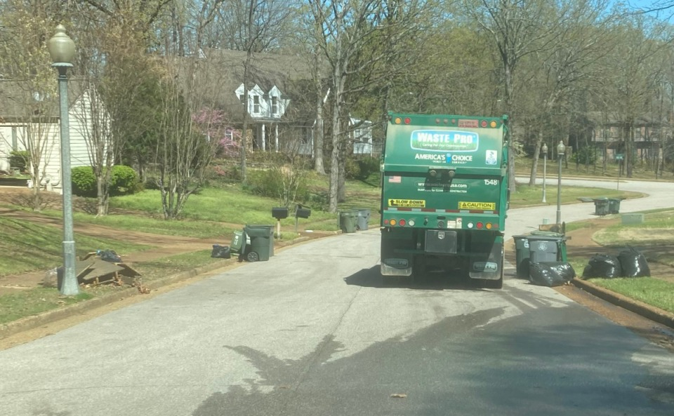<strong>A Waste Pro truck makes its way through Countrywood on Monday, March 29, 2021. Waste Pro says it wanted to collect waste on Good Friday, April 2, but the request was denied by the city.</strong> (David Boyd/Daily Memphian)