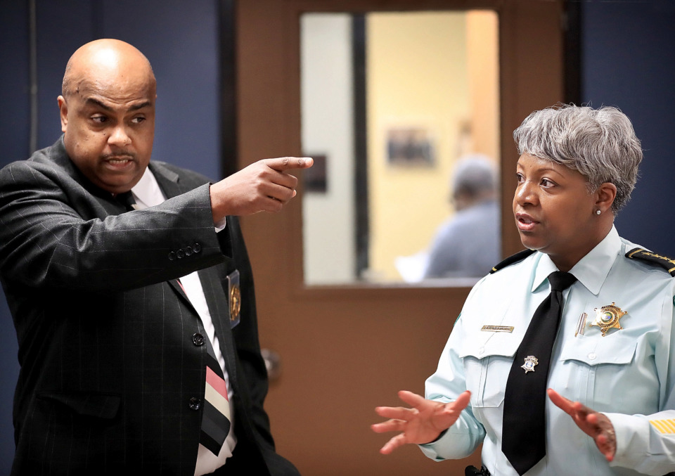 <strong>Shelby County Sheriff's Office chief jailer Kirk Fields (left) and assistant chief Deidra Bridgeforth talk about the intake and processing area during a tour of the Shelby County Juvenile Detention Center on Jan. 18, 2019. Bridgeforth said conditions at the aging center are poor, including not having enough space for the Hope Academy school there.</strong> (Jim Weber/Daily Memphian)