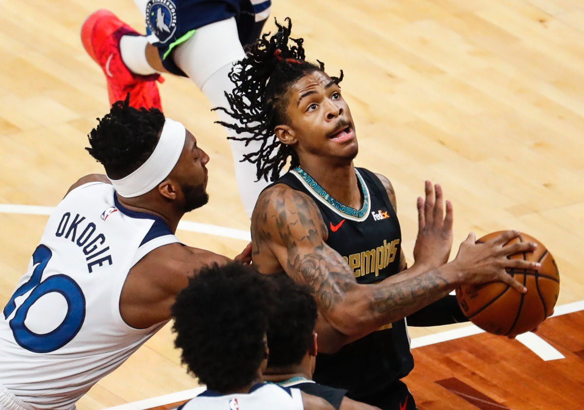 <strong>Grizzlies guard Ja Morant (right) drives the lane against Minnesota&rsquo;s Josh Okogie (left) on Friday, April 2, 2021, at FedExForum.</strong> (Mark Weber/The Daily Memphian)
