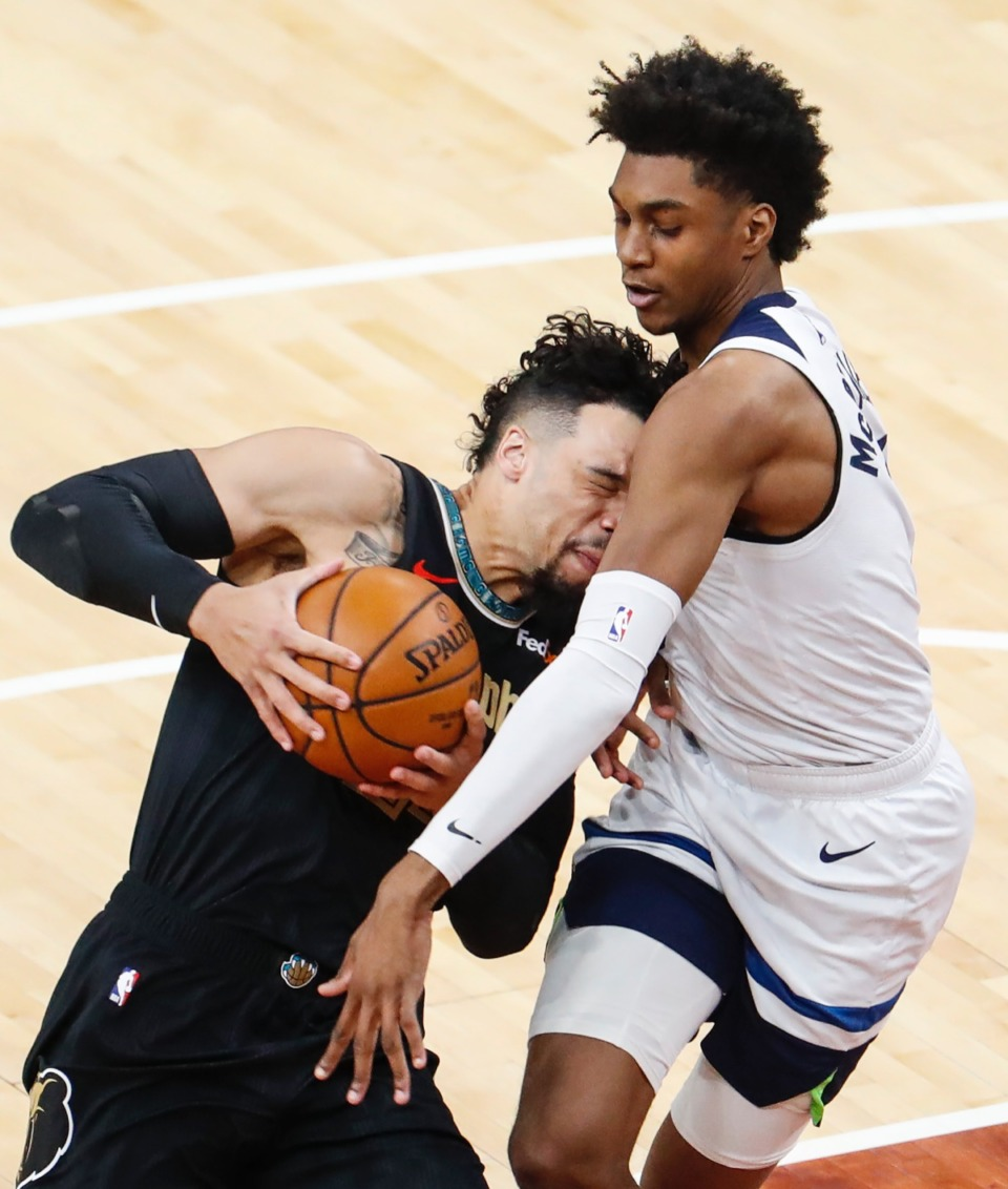 <strong>Grizzlies guard Dillion Brooks (left) drives into Minnesota&rsquo;s Jaden McDaniels (right) on April 2.</strong> (Mark Weber/The Daily Memphian)