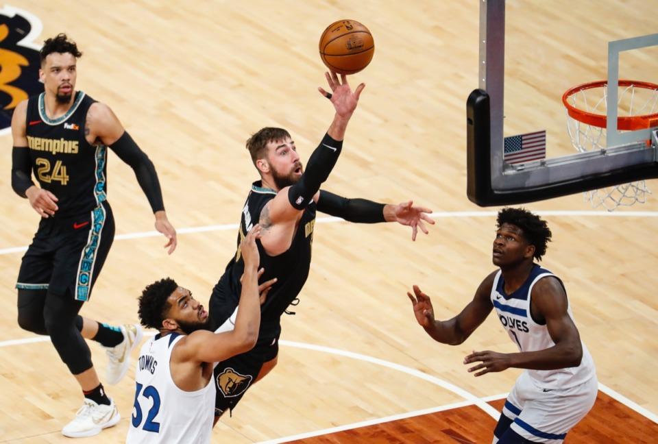 <strong>Grizzlies center Jonas Valanciunas (middle) shoots against Minnesota&nbsp;on April 2.</strong> (Mark Weber/The Daily Memphian)