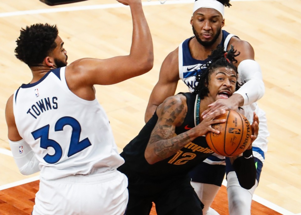 <strong>Grizzlies guard Ja Morant (middle) is fouled while driving to the basket against Minnesota&rsquo;s Karl-Anthony Towns (left) and Josh Okogie (right) on April 2.</strong> (Mark Weber/The Daily Memphian)