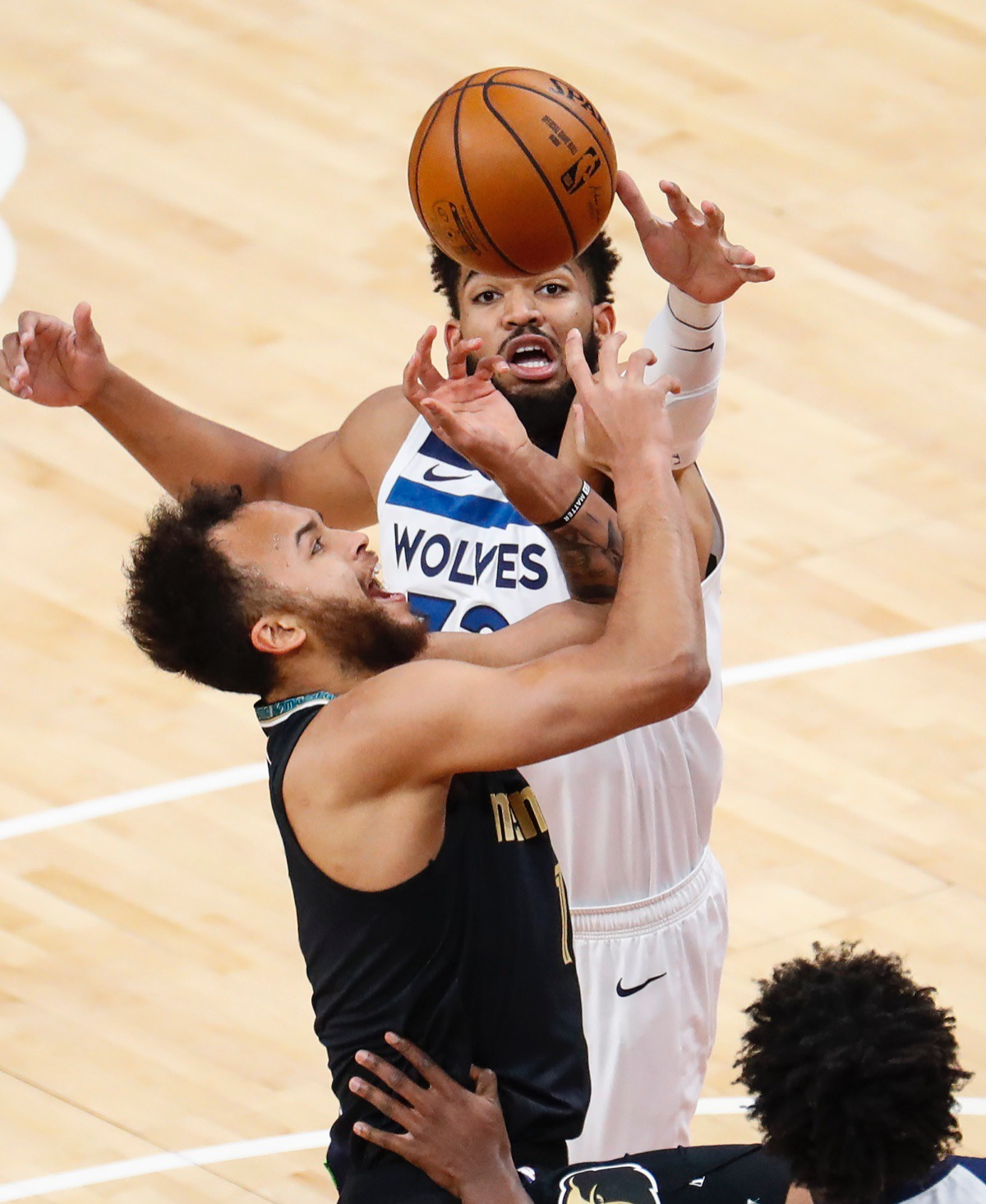 <strong>Grizzlies forward Kyle Anderson (front) has his shot blocked by Minnesota&rsquo;s Karl-Anthony Towns (back) on April 2.</strong> (Mark Weber/The Daily Memphian)