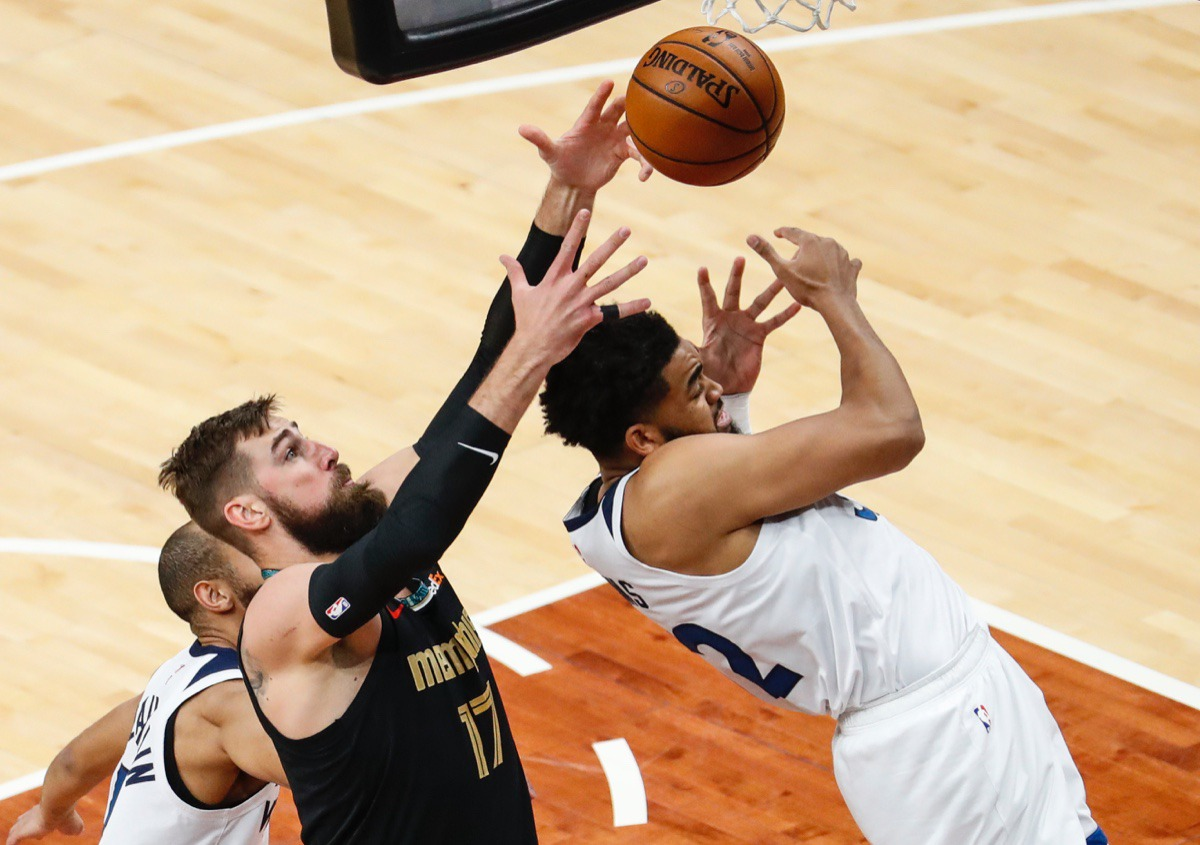 <strong>Grizzlies center Jonas Valanciunas (left) grabs a rebound away from Minnesota&rsquo;s Karl-Anthony Towns (right) on April 2.</strong> (Mark Weber/The Daily Memphian)