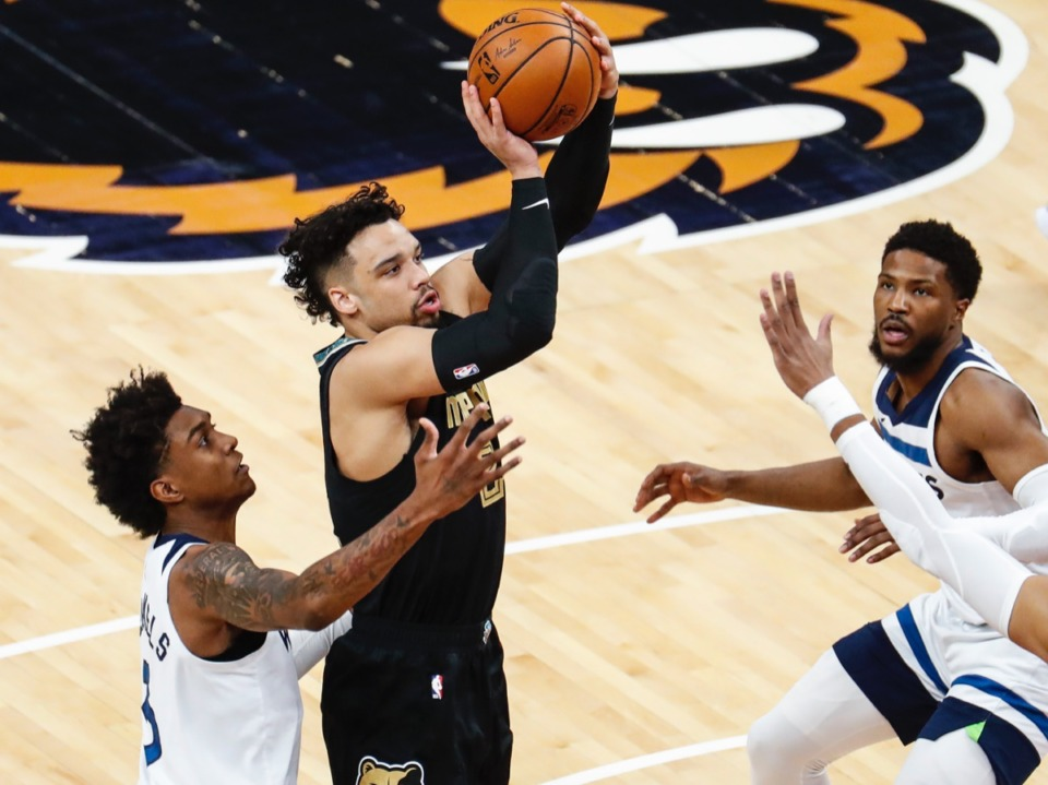 <strong>Grizzlies guard Dillion Brooks (middle) shoots against Minnesota on April 2.</strong> (Mark Weber/The Daily Memphian)