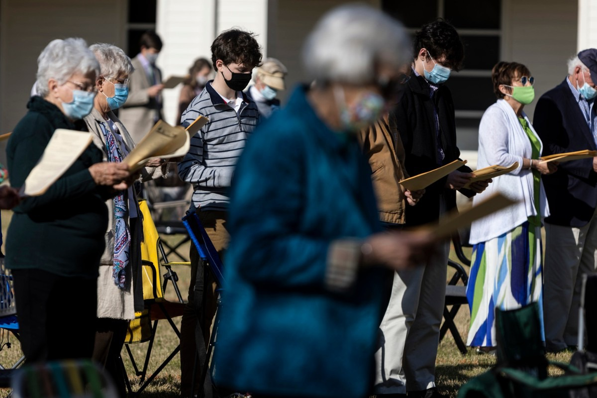 <strong>Congregants stand to pray during the St. George&rsquo;s Episcopal Church outdoor Easter service in Germantown.</strong> (Brad Vest/Special to The Daily Memphian)