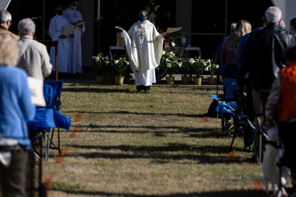 <strong>Orange squares painted on the grass encourage social distancing&nbsp; at St. George&rsquo;s Episcopal Church where Rev. Dr. Dorothy Sanders Wells leads the Easter service.</strong> (Brad Vest/Special to The Daily Memphian)