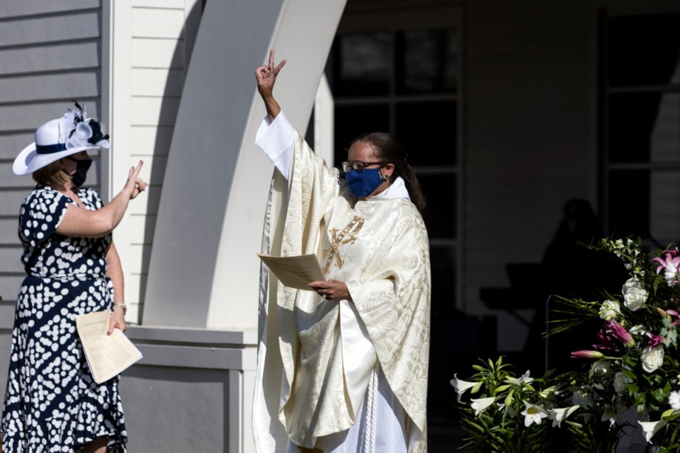 <strong>Rev. Dr. Dorothy Sanders Wells (right) greets arrivals Sunday at St. George&rsquo;s Episcopal Church&rsquo;s outdoor Easter service in Germantown.</strong> (Brad Vest/Special to The Daily Memphian)