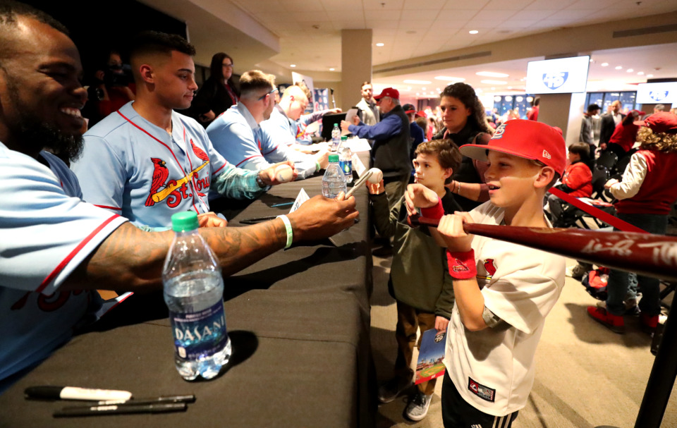 <strong>Adolis Garc&iacute;a (left), a former Redbirds right fielder, signs an autograph for Thomas Starrett (right), 10, during the Cardinals Caravan event at AutoZone Park Friday, Jan. 18, 2019. Visitors filled the second floor of the stadium to hear their favorite players speak about what it takes to make it to the major leagues.</strong> (Houston Cofield/Daily Memphian)