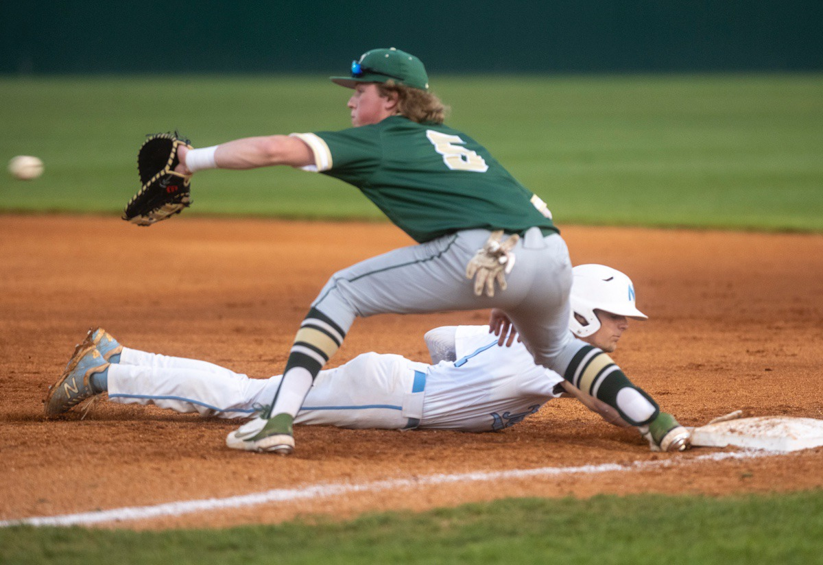 <strong>FACS first baseman Tyler Kamler (5) reaches for the throw as Northpoint's Anthony Zarlingo (1) slides back to first base Monday in Southaven.</strong> (Greg Campbell/Special to The Daily Memphian)