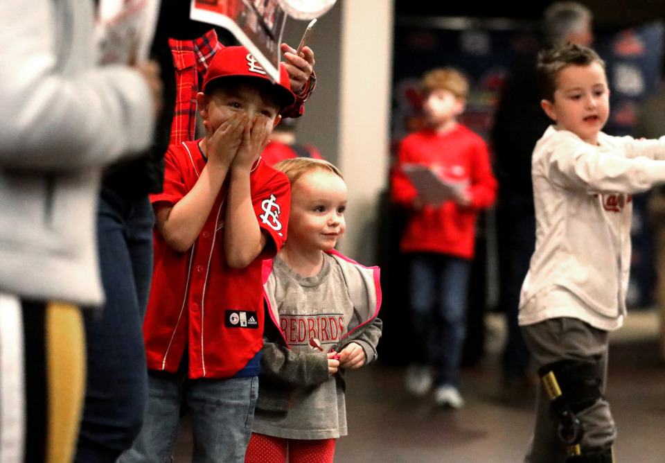 <strong>Russell Chailland (left), 7, and his sister Madison Chailland (right), 3, gasp as Rockey the Redbird runs into a crowd during the Cardinals Caravan event on Friday, Jan. 18, 2019.</strong>&nbsp;(Houston Cofield/Daily Memphian)