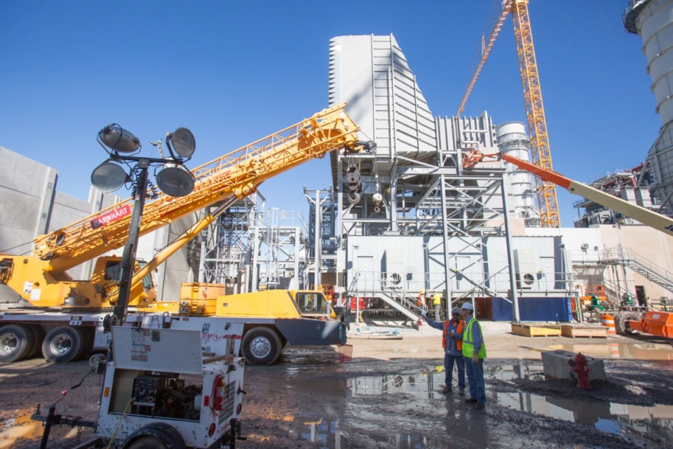 <strong>A crew from Barnhart Electric prepares to install a transformer near one of the gas turbines at TVA's new natural gas power plant. The Memphis City Council is once again looking at alternatives to TVA as MLGW&rsquo;s power supplier.</strong> (Daily Memphian file)
