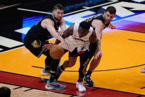 <strong>Miami Heat guard Victor Oladipo, middle, and Memphis Grizzlies center Killian Tillie, left, and guard John Konchar (46) go after the ball on April 6, 2021, in Miami.</strong> (Marta Lavandier/AP)