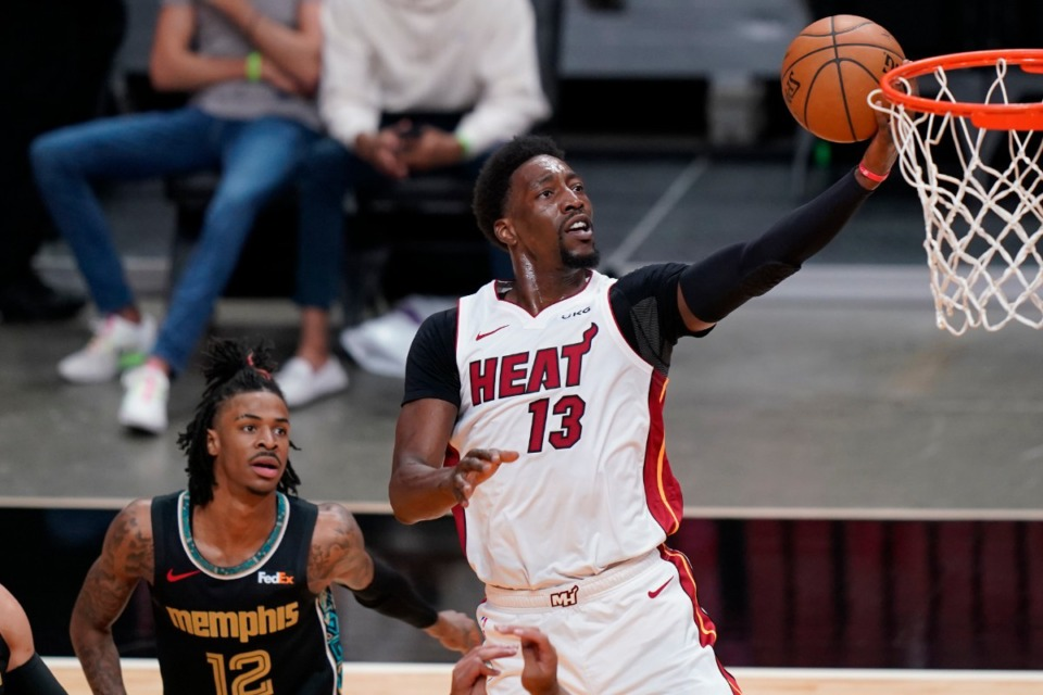 <strong>Miami Heat center Bam Adebayo (13) drives to the basket over Memphis Grizzlies guard Ja Morant (12) on Tuesday, April 6, in Miami.</strong> (Marta Lavandier/Associated Press)