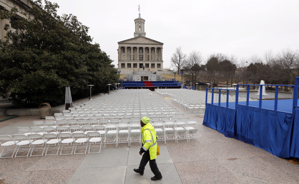 <strong>A man walks across War Memorial Plaza near the Tennessee State Capitol Friday, Jan. 18, 2019, in Nashville, Tenn., where preparations have been made for the inauguration of Tennessee Gov.-elect Bill Lee on Saturday. Lee's inauguration is being moved indoors to the War Memorial Auditorium because of forecasts for weekend rain and thunderstorms.</strong> (AP Photo/Mark Humphrey)