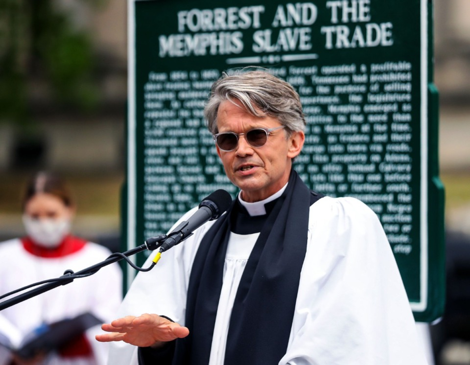 <strong>Rev. Scott Walters speaks during a rededication ceremony on Wednesday, April 7, of a historical marker noting the location of the Downtown slave market owned by Nathan Bedford Forrest. The marker stands at the southwest corner of Adams Avenue and B.B. King Boulevard near a 1950s-era historical marker that noted the land was the site of Forrest's Memphis home. That marker made no mention of the slave market.</strong> (Patrick Lantrip/Daily Memphian)