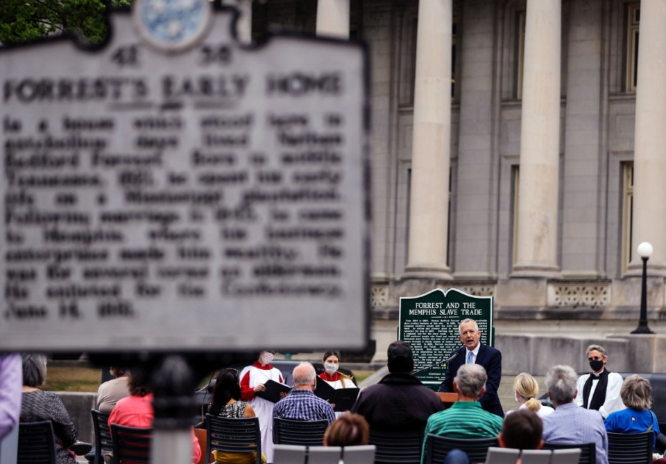 <strong>Tim Huebner speaks at the rededication Wednesday, April 7, of a marker noting the location of the Downtown slave market owned by Nathan Bedford Forrest. The marker was erected as a response to a 1950s-era historical marker that failed to mention how Forrest made his fortune</strong>. (Patrick Lantrip/Daily Memphian)