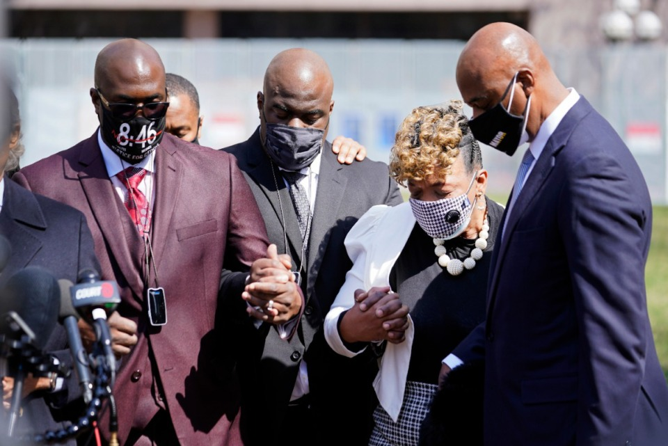 <strong>Philonise Floyd, left, the brother of George Floyd, and other family members along with Gwen Carr, the mother of Eric Garner, take part in a prayer vigil led by the Rev. Al Sharpton outside the Hennepin County Government Center during lunch break Tuesday, April 6, 2021, in Minneapolis.</strong>&nbsp; (Jim Mone/AP file)