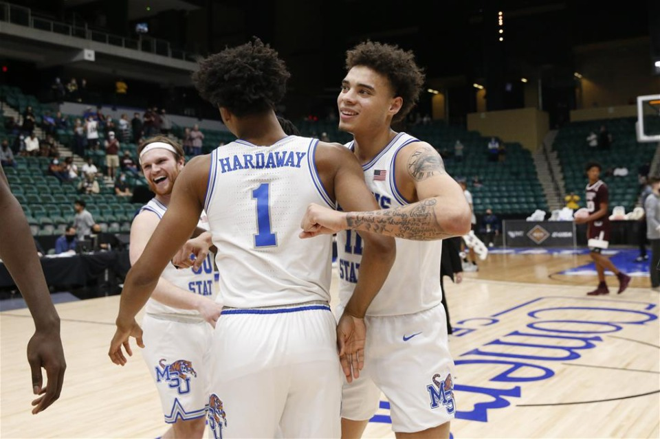 <strong>Conor Glennon (left), Jayden Hardaway and Lester Quinones celebrate after defeating Mississippi State in the NIT basketball tournament March 28, 2021.</strong> (courtesy NCAA)