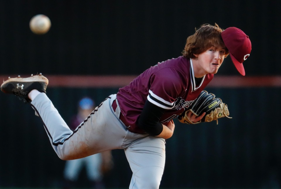 <strong>Collierville pitcher Bryce Griffith loses his cap while making a throw to home plate in the game against Houston on Thursday, April 8, 2021.</strong> (Mark Weber/The Daily Memphian)