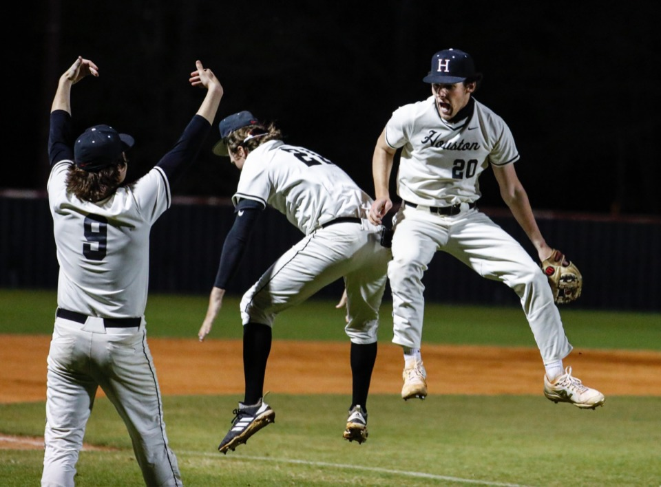 <strong>Houston relief pitcher Dean McCalla (right) celebrates an out against Collierville on April 8.</strong> (Mark Weber/The Daily Memphian)