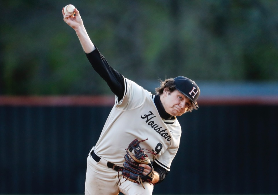 <strong>Houston starting pitcher Brady Jones makes a throw to home plate against Collierville on April 8.</strong> (Mark Weber/The Daily Memphian)
