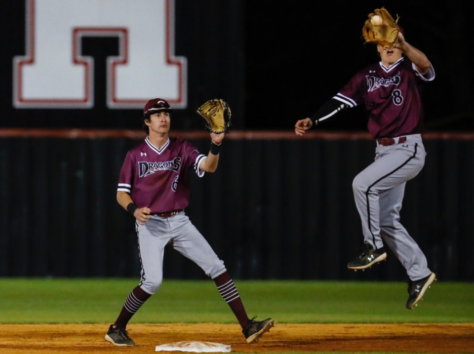 <strong>Collierville second baseman Seth Brown (right) cuts off a throw to shortstop Thomas Crabtree (left) to make a throw to home plate against Houston on April 8.</strong> (Mark Weber/The Daily Memphian)