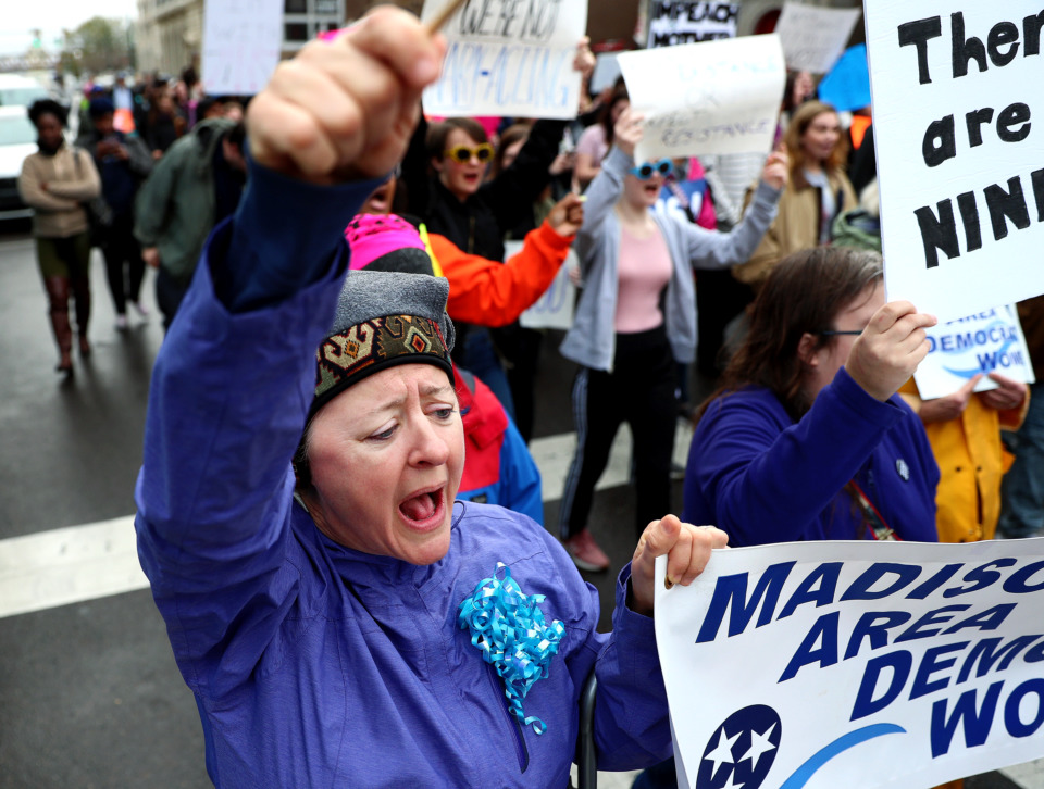 <strong>Kristen McKenney chants along with other protesters during the 2019 women's march as she makes her way down Adams Street toward the courthouse in Downtown Memphis.</strong> (Houston Cofield/Daily Memphian)