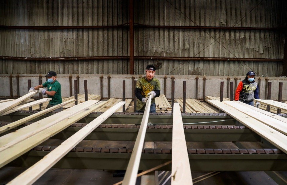 <strong>Workers sort lumber at Classic American Hardwood on Friday, April 2.</strong> <strong>The 50-acre lumber mill with 180 employees in North Memphis just recorded the best month in its 21-year-history, chief executive Bill Courtney said.</strong> (Mark Weber/Daily Memphian)