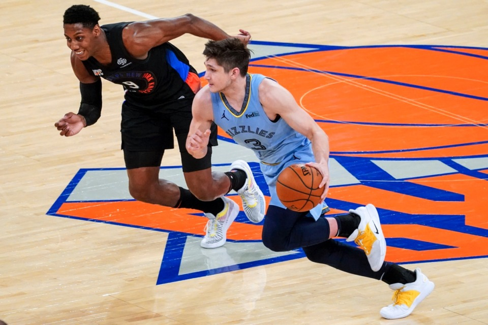 <strong>Grizzlies guard Grayson Allen (3) drives against New York Knicks guard R.J. Barrett (9) on April 9, 2021, at Madison Square Garden in New York.</strong> (Mary Altaffer/AP pool)