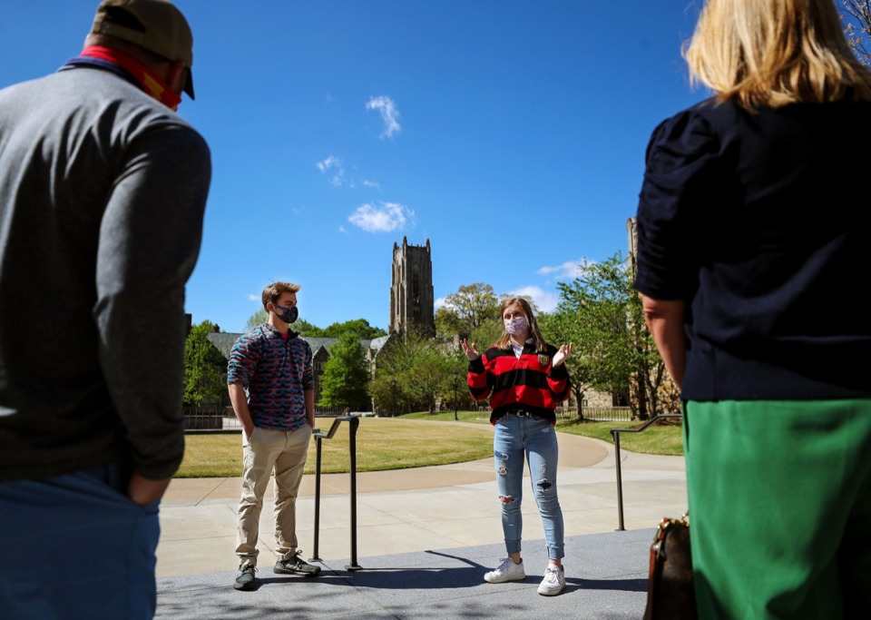 <strong>Rhodes College student Anna Littleton (right) leads a campus tour for prospective students and parents April 8, 2021.</strong> (Patrick Lantrip/Daily Memphian)