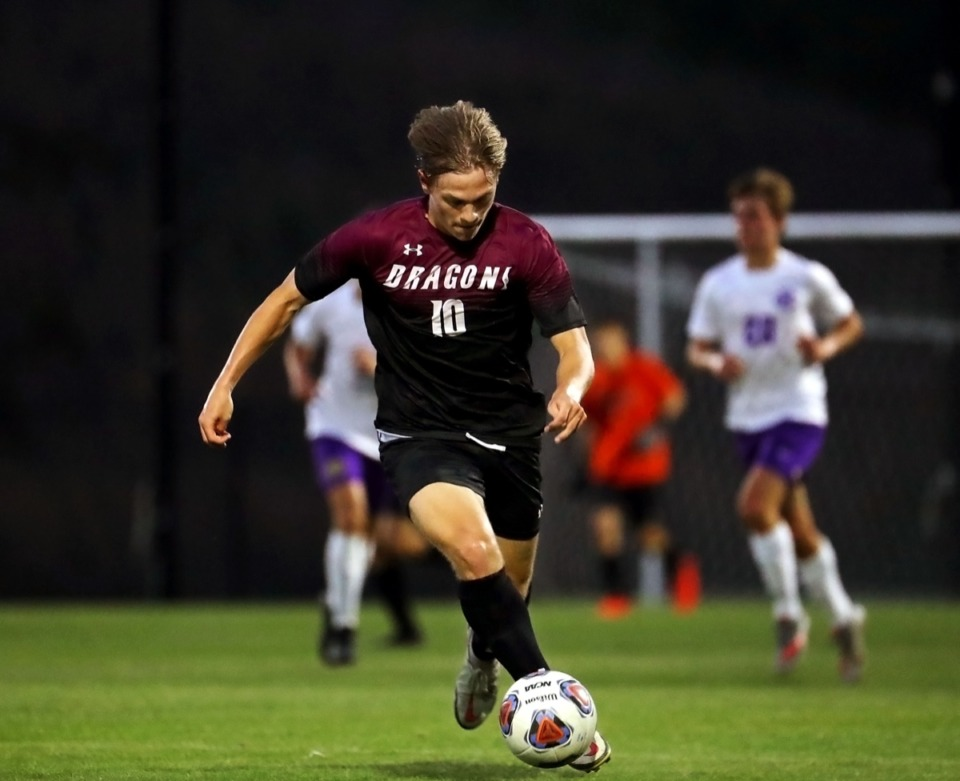 <strong>Collierville's Micah Soper (10) brings the ball upfield on April 9 in the game against CBHS.</strong> (Patrick Lantrip/Daily Memphian)
