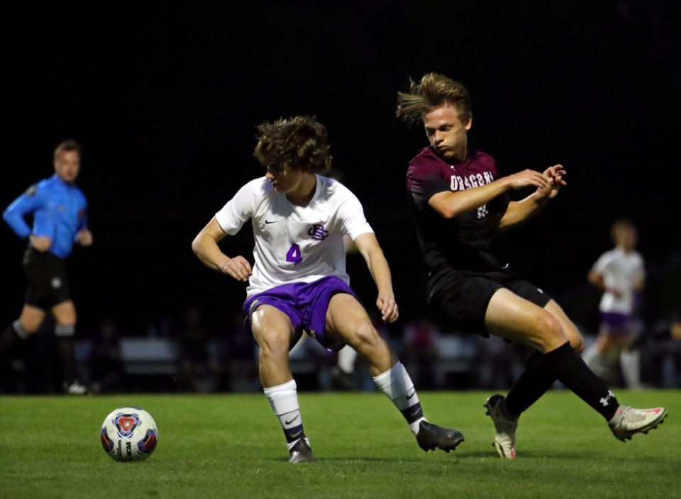 <strong>Collierville's Micah Soper (10) fights for a loose ball against a CBHS defender on April 9.</strong> (Patrick Lantrip/Daily Memphian)