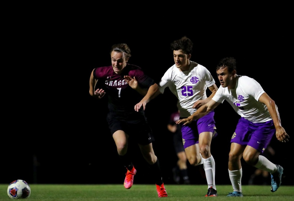 <strong>Collierville's Luke Johnson (7) fights off two CBHS defenders during an April 9 match.</strong> (Patrick Lantrip/Daily Memphian)