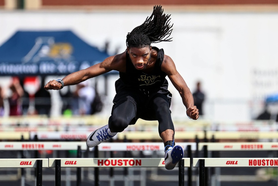 <strong>Whitehaven's Travion Jones competes in the men's 110 meter hurdles at the Houston Track and Field Classic at Houston High School April 10, 2021.</strong> (Patrick Lantrip/Daily Memphian)