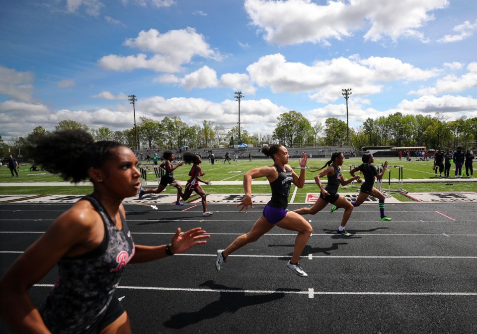 <strong>Southwind's JaCaiyah Tutwiler (center) runs in the women's 100 meter dash at the Houston Track and Field Classic at Houston High School April 10, 2021.</strong> (Patrick Lantrip/Daily Memphian)