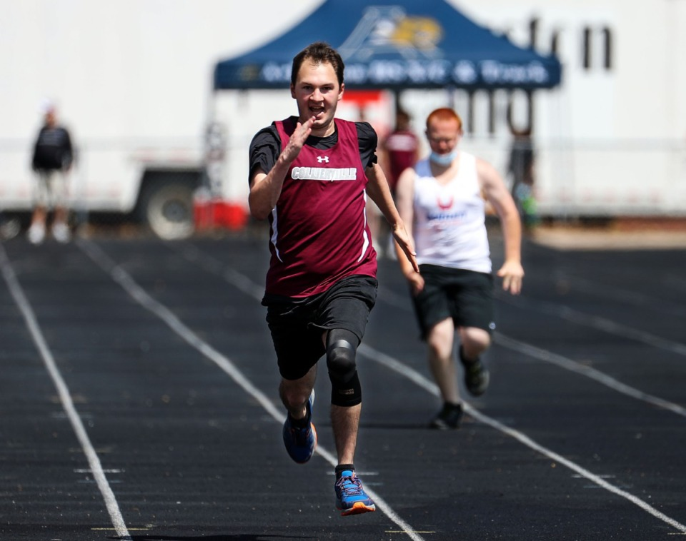 <strong>Collierville's Matthew Bell runs the unified 100 meter dash at the Houston Track and Field Classic at Houston High School April 10, 2021.</strong> (Patrick Lantrip/Daily Memphian)