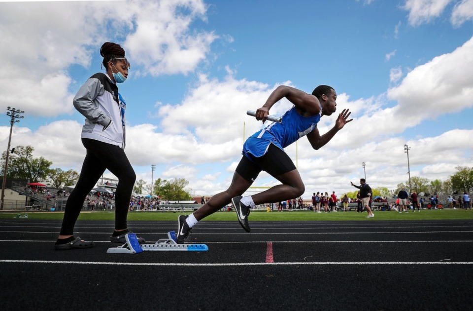 <strong>Harding's Jordan Jarrett starts off the block in the men's 4x200 meter relay at the Houston Track and Field Classic at Houston High School April 10, 2021.</strong> (Patrick Lantrip/Daily Memphian)
