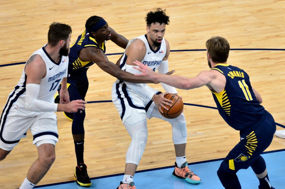 <strong>Memphis Grizzlies forward Dillon Brooks handles the ball against Indiana Pacers forwards Domantas Sabonis (11) and Justin Holiday in an NBA basketball game Sunday, April 11, 2021, at FedExForum.</strong> (Brandon Dill/AP)