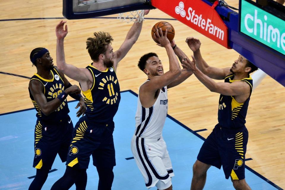 <strong>Memphis Grizzlies forward Kyle Anderson shoots between Indiana Pacers guard Caris LeVert (22), forward Domantas Sabonis (11), and guard Malcolm Brogdon in an NBA basketball game Sunday, April 11, 2021, at FedExForum.</strong> (Brandon Dill/AP)