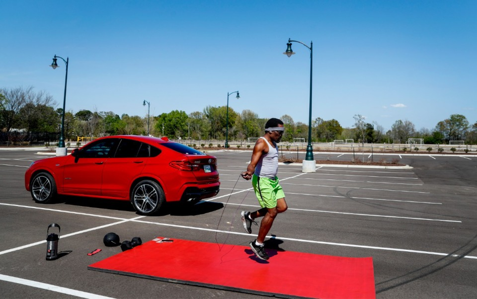 <strong>Tavares Williams jumps rope while working out in the parking lot of Arlington's recently opened Forrest Street Park on Tuesday, April 6, 2021. The park features a new amphitheater, pavilion, walking trails, garden and will be home to a farmers market set to open April 24.</strong> (Mark Weber/The Daily Memphian)