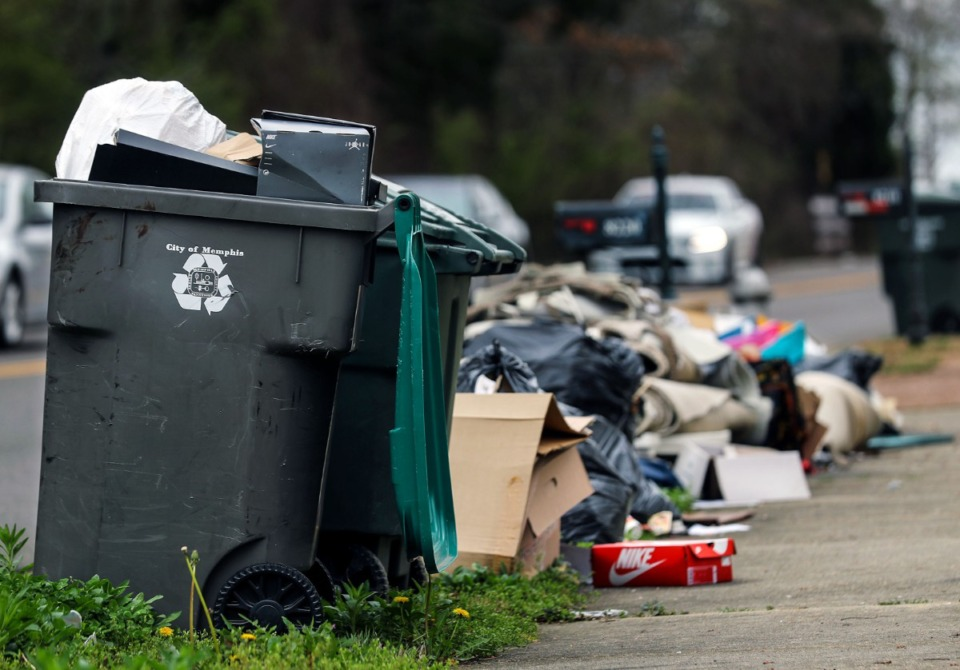 <strong>A pile of trash grows along Cordova Road on March 23, awaiting pick-up by Waste Pro.&nbsp;Since being hired on emergency terms April 2, Team Waste has leased 26 trucks and hired more than 30 employees to deal with Area E, which includes Cordova.</strong>&nbsp;(Patrick Lantrip/Daily Memphian)