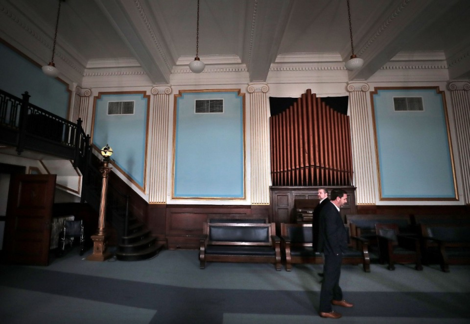 <strong>Jeff Higdon (right) walks back old-fashioned decor in the Masonic Lodge on Court Avenue.</strong> (Jim Weber/Daily Memphian file)