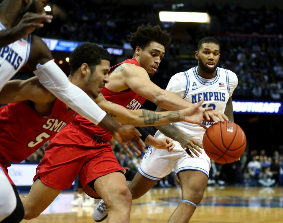<strong>University of Memphis forward Mike Parks Jr. (10) races for the ball amidst a handful of Southern Methodist University players.</strong> (Houston Cofield/Daily Memphian)