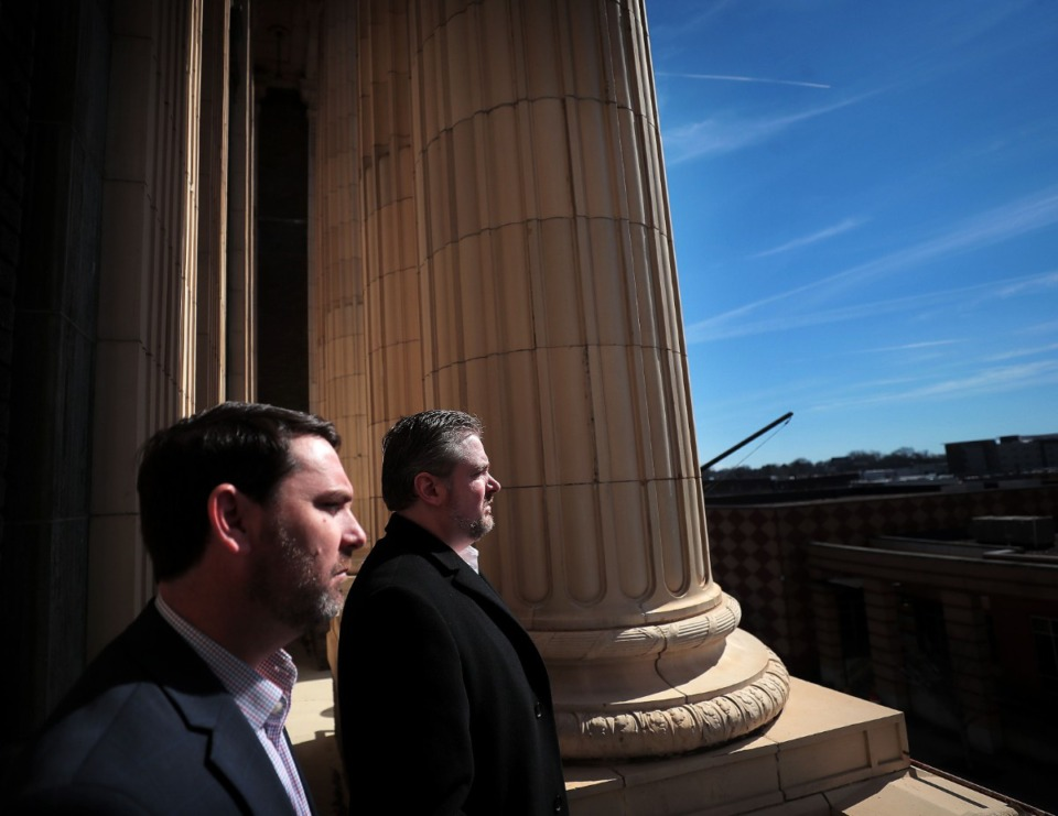 <strong>Jeff Higdon (left) and past master Mason and broker James McCraw face outward from the Masonic Lodge in 2020.</strong> (Jim Weber/Daily Memphian file)