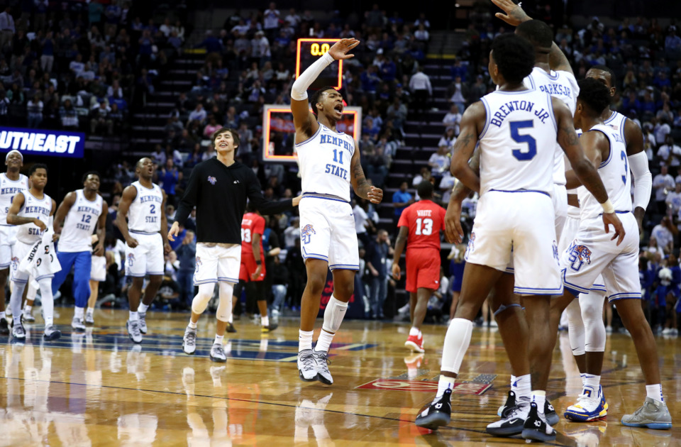 <strong>University of Memphis guard Antwann Jones (11) celebrates with teammates after the Tigers score right before halftime against Southern Methodist University.</strong> (Houston Cofield/Daily Memphian)