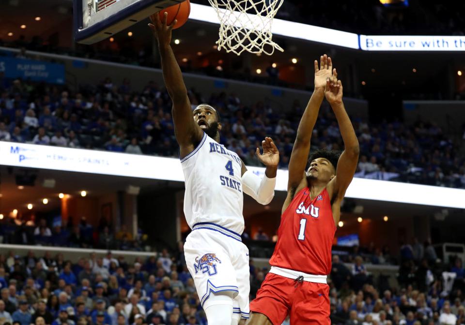 <strong>University of Memphis forward Raynere Thornton (4) leaps for a lay-up against Southern Methodist University forward Feron Hunt (1).</strong> (Houston Cofield/Daily Memphian)